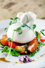 burrata, fresh italian cheese made from mozzarella and cream
