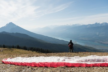 Paraglider standing on mountain