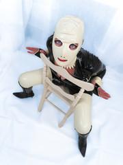 Sitting creepy living doll. Big blue eyes. Latex hood.