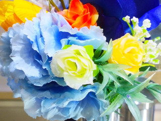 Close-up several colorful artificial flowers bouquet background. Love concept.