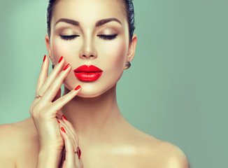 Wall Mural - Beautiful fashion sexy woman with red lipstick and red nails