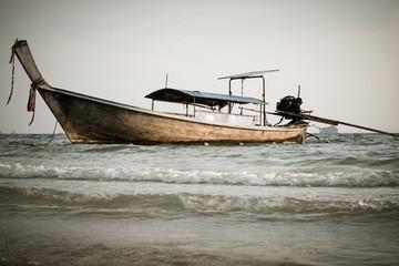 Longtail boats at the tropical beach of Krabi, Andaman sea, Thailand.