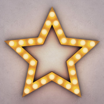 Golden retro star with glowing light bulbs on concrete background. 3D rendering