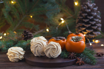 Homemade marshmallows or zephyr with persimmon flavour on the wooden background