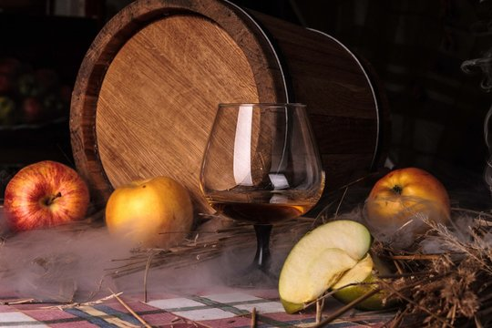Still life with alcohol and apples