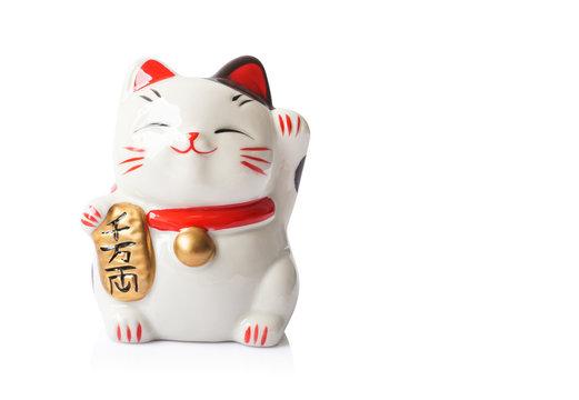 Maneki Neko ceramic japanese lucky cat isolated on white background