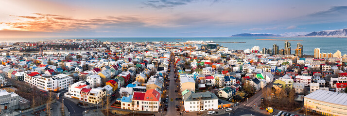 Fototapete - Aerial panorama of downtown Reykjavik at sunset with colorful houses and commercial streets