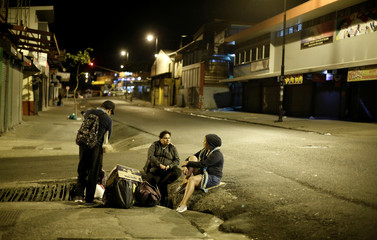 People living on the streets take part during an event held to celebrate Christmas for homeless people organized by the Association of the Holy Spirit, in San Jose