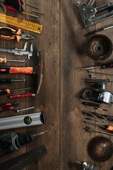 A construction tool on a brown wooden background. View from above. Picture background, screensaver. The concept of construction, repair, construction, production, design. Copy space.
