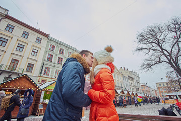 Young couple kissing at wintertime outdoors