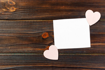 blank paper note with heart shape on grunge wooden background