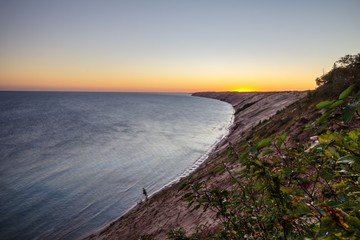 Pictured Rocks National Lakeshore. Sunrise along massive sand dune peninsula at the Pictured Rocks National Lakeshore in Grand Marais, Michigan, USA.