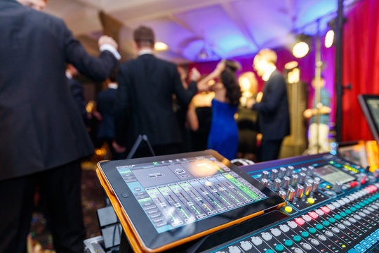 The disco, Banquet, people blurred background dancing. Dj panel