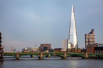 London cityscape with Southwark Bridge and Shard skyscraper