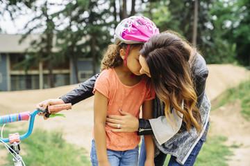Mom comforting daughter after bike crash