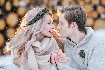 Couple in love warms each other's hands. Winter wedding. Close-up portrait of Beautiful newlyweds.