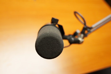 Microphone in the radio studio on a yellow background