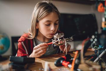Wall Mural - Girl learning robotics