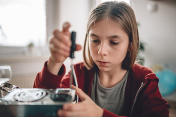 Wall Mural - Girl modifying power supply and  learning robotics