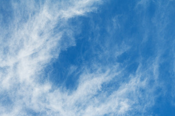 White feather clouds against a bright blue sky (background)