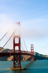 The phases of the Golden Gate Bridge in San Francisco is getting covered with fog and/or cloud
