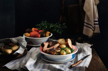 Plate of grilled beef steak and fried potatoes. Rustic style