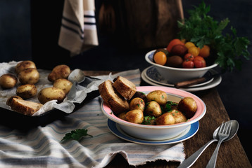 Rustic style. Plate of fried potatoes on wooden table