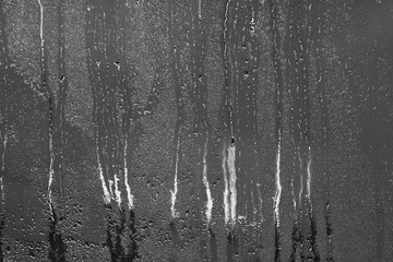 Natural сondensation background. High humidity. Texture of water droplets on window