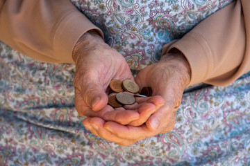 Elderly caucasian woman holding money in her hands