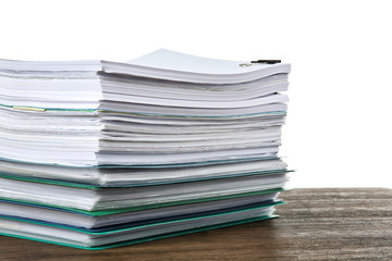 Stack of documents on table against white background
