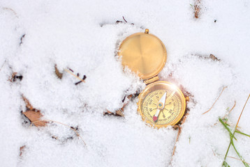 Compass in a snow background.