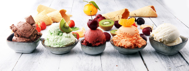 Set of ice cream scoops of different colors and flavours with berries, nuts and fruits Wall mural