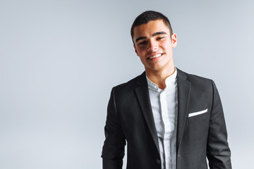 handsome young man in a stylish suit, posing on a white background isolated