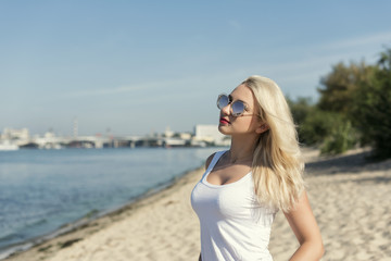 Young blond woman resting on the beach