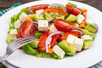 Dietary salad of fresh vegetables with avocado and goat cheese
