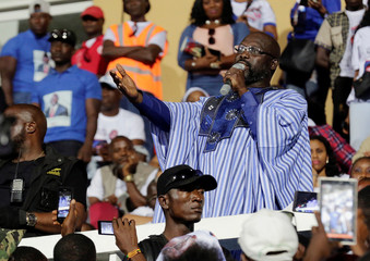 Weah, former soccer player and presidential candidate of Congress for Democratic Change (CDC), delivers a speech during the party's presidential campaign rally at Samuel Kanyon Doe Sports Complex in Monrovia, Liberia