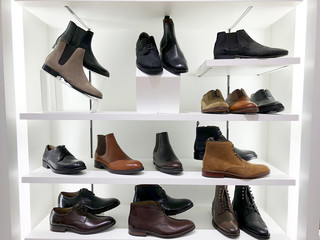 Picture of the store shelf with men's shoes.