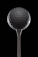 Golf ball on golf tee highlighted