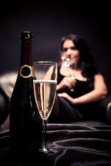 Young Woman Enjoying A Glass Of Champagne