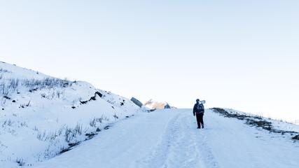 Tourist climber on a mountain snow trail