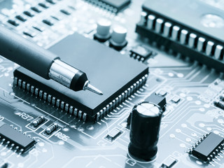 Circuit board with electronic components background. Electronic circuit board with parts