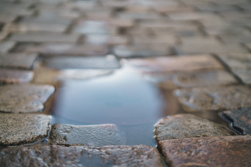 puddle on old stone pavement background