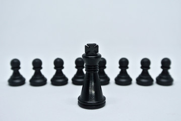 King and pawn black chess pieces isolated on white background