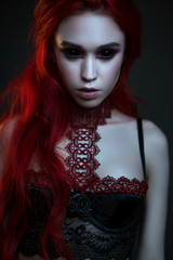 Portrait beautiful gothic vampire woman inlingerie and black eyes