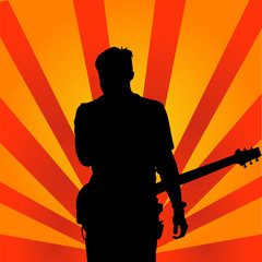 Rock band performs on stage. Guitarist plays solo. rock singer with a guitar. rock star