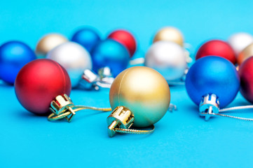 Colorful Christmas balls on blue background.