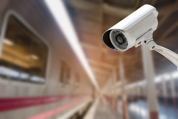 CCTV Camera security operating with abstract blurred of train station