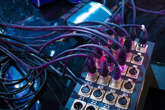 black microphone cables connected to the sound mixer