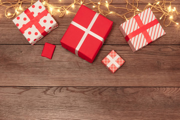 A frame of Christmas decorations and gifts on a wooden table. Holidays christmas background. Copyspace for text or design. View from above.