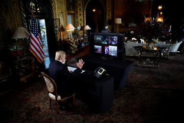 U.S. President Donald Trump participates in a Christmas Eve video teleconference with members of the military at Mar-a-Lago estate in Palm Beach, Florida, U.S.